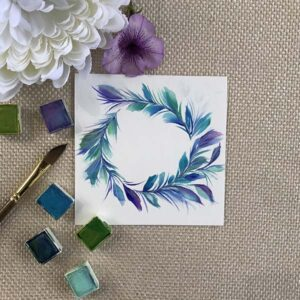 I'm completely obsessed with this color palette, the watercolor dagger brush and this feathery wreath.