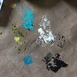 Splat mat full of acrylic paint